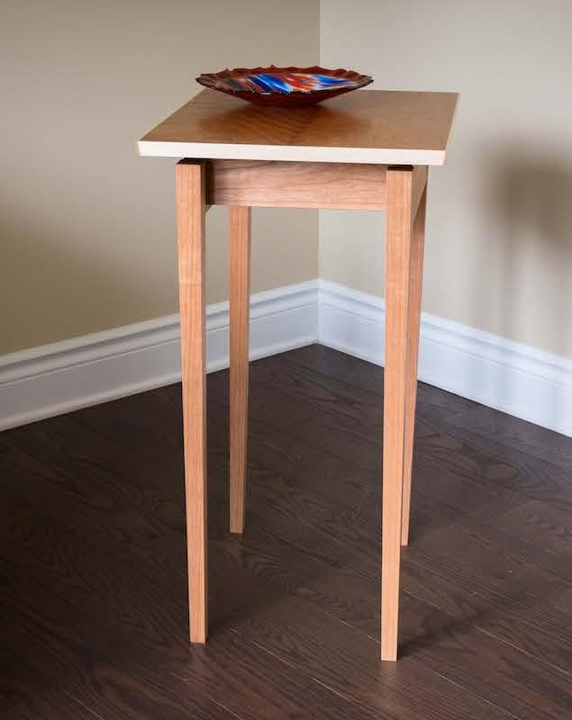 Side table with floating top